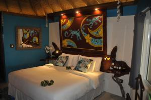 A bed or beds in a room at Mango Island Lodges