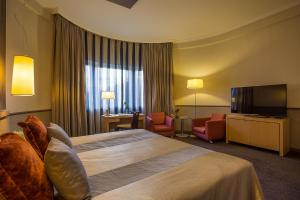 A bed or beds in a room at Mamaison Hotel Andrassy Budapest