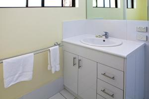 A bathroom at Palms At Trinity