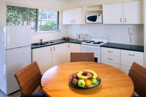 A kitchen or kitchenette at Palms At Trinity