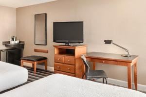 A television and/or entertainment centre at Royal Hotel Regina, Trademark Collection by Wyndham