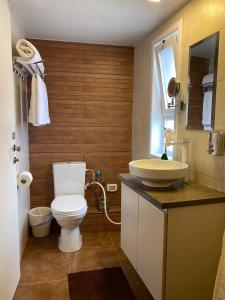 A bathroom at Boutique Apartments - Avrooms Place