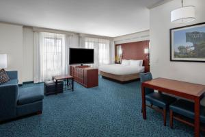 A television and/or entertainment center at Residence Inn by Marriott Cincinnati Downtown/The Phelps