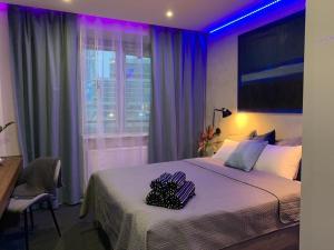Postel nebo postele na pokoji v ubytování #7A WorkTravel Central MiniApart