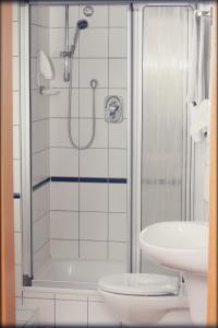 Ein Badezimmer in der Unterkunft Hotel in
