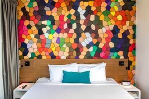 A bed or beds in a room at ibis Styles Brisbane Elizabeth Street