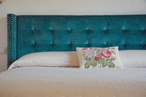 Łóżko lub łóżka w pokoju w obiekcie Hotel Sa Vall