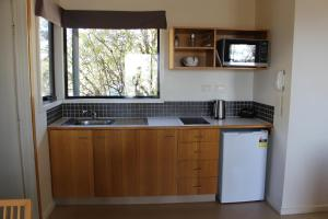 A kitchen or kitchenette at Cradle Mountain Wilderness Village