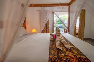 A bed or beds in a room at Balengku Homestay