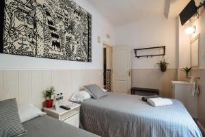 Cama o camas de una habitación en El Viajero en Sevilla