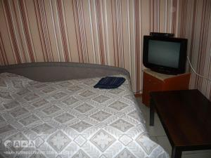 A television and/or entertainment center at Viktoria Hotel
