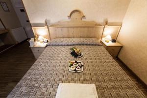 Кровать или кровати в номере Rifugio Sapienza