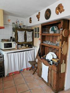 A kitchen or kitchenette at Hostel Argonauta