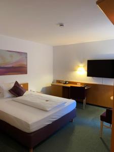 Ein Bett oder Betten in einem Zimmer der Unterkunft Hotel Schober