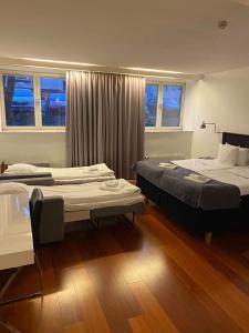 Säng eller sängar i ett rum på Hotell Alfred Nobel