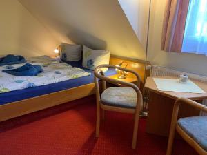 Ein Bett oder Betten in einem Zimmer der Unterkunft Pension Richter