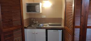A kitchen or kitchenette at Apartamentos del Rey