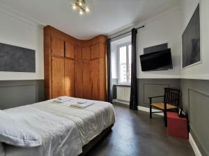 Un ou plusieurs lits dans un hébergement de l'établissement CoolHouse at Colosseo