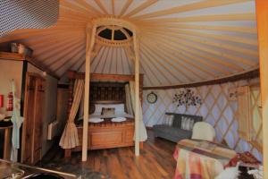 A bed or beds in a room at Wall Eden Farm Luxury Log Cabins