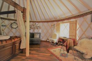 A seating area at Wall Eden Farm Luxury Log Cabins