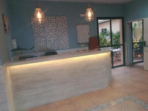 El vestíbulo o zona de recepción de Hostal Boutique Macavi