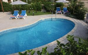 The swimming pool at or near Bay Villas