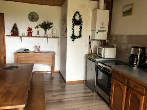 A kitchen or kitchenette at Les Lauzes du Mas