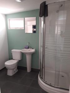 Um banheiro em Palm Trees Apartments