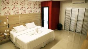 A bed or beds in a room at Tezla Hotel