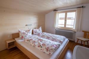 Ein Bett oder Betten in einem Zimmer der Unterkunft GreberHof