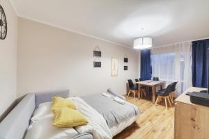 Łóżko lub łóżka w pokoju w obiekcie Dream Loft Podwale Staromiejskie