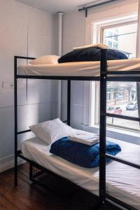 A bunk bed or bunk beds in a room at The Cambie Hostel Seymour