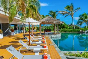 The swimming pool at or near Koi Resort Saint Kitts, Curio Collection by Hilton