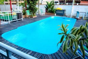 A piscina localizada em Pousada Vila do Parque ou nos arredores