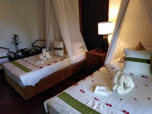 A bed or beds in a room at Emerald Sea Resort