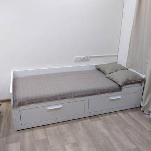 A bed or beds in a room at Квартира