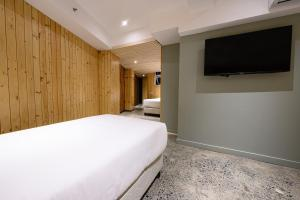 A bed or beds in a room at G1 Lodge