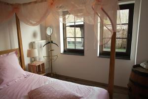 Un ou plusieurs lits dans un hébergement de l'établissement Guest house Western-city