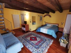 A bed or beds in a room at All'Imperatore