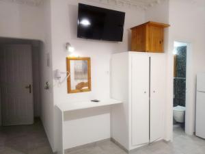 Un televizor și/sau centru de divertisment la Hotel Perissa