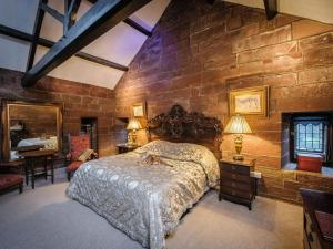 A bed or beds in a room at Dalston Hall Country House Hotel