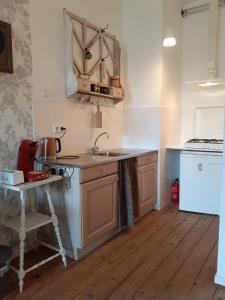 Een keuken of kitchenette bij BenB Groningen