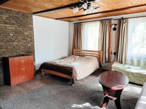A bed or beds in a room at Synya Gora