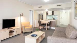 A television and/or entertainment center at Oaks Brisbane on Charlotte Suites