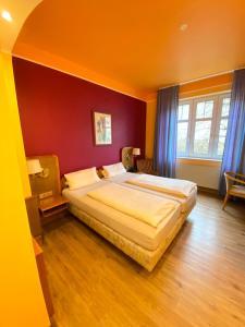 Ein Bett oder Betten in einem Zimmer der Unterkunft Hotel da Rosario