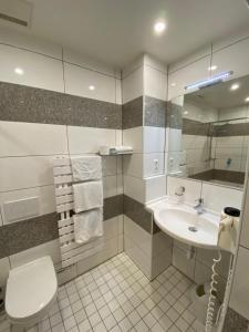 Ein Badezimmer in der Unterkunft Hotel da Rosario