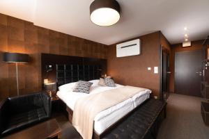 Un ou plusieurs lits dans un hébergement de l'établissement Interhotel Tatra