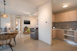 A kitchen or kitchenette at Trianon Luxury Apartments & Suites