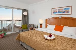 A bed or beds in a room at David Dead Sea Resort & Spa
