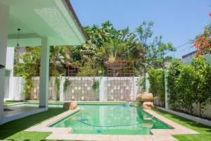 The swimming pool at or near Angel Guest House - Beach Front